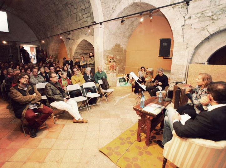 Sant Joan Degollat escolta a Carme Riera